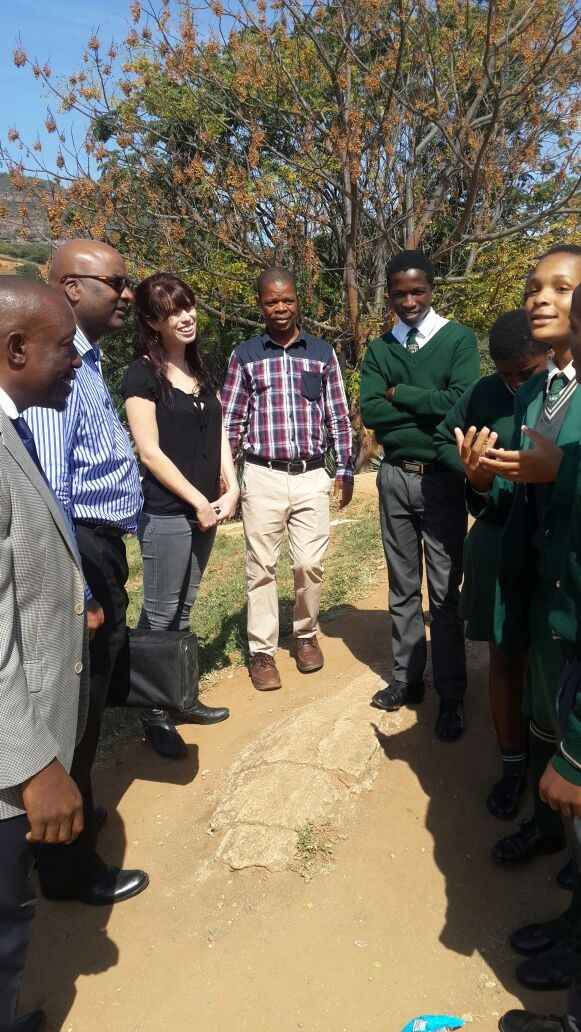 Mr Masinga (the principal), Clive (a Seartec staff member), Tal (a seartec staff member) amd one of the maths teachers listening to the speech of gratitude from Hlahledlela students