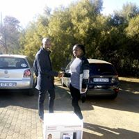 Thabo handing over the Sharp 34l grill microwave