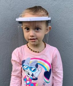 little girl with face shield
